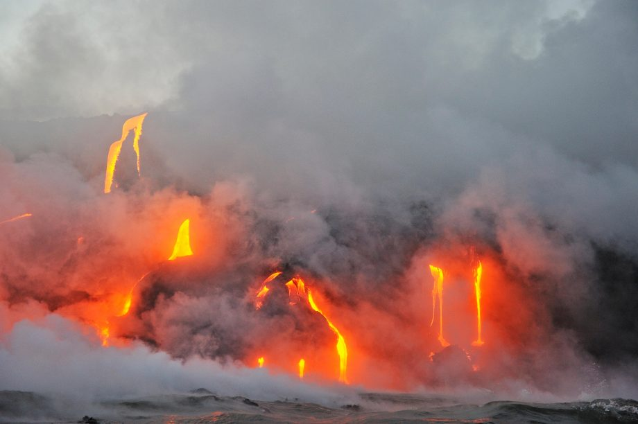 Molten lava flowing to the sea from Kilauea Volcano, Big Island, Hawaii, USA