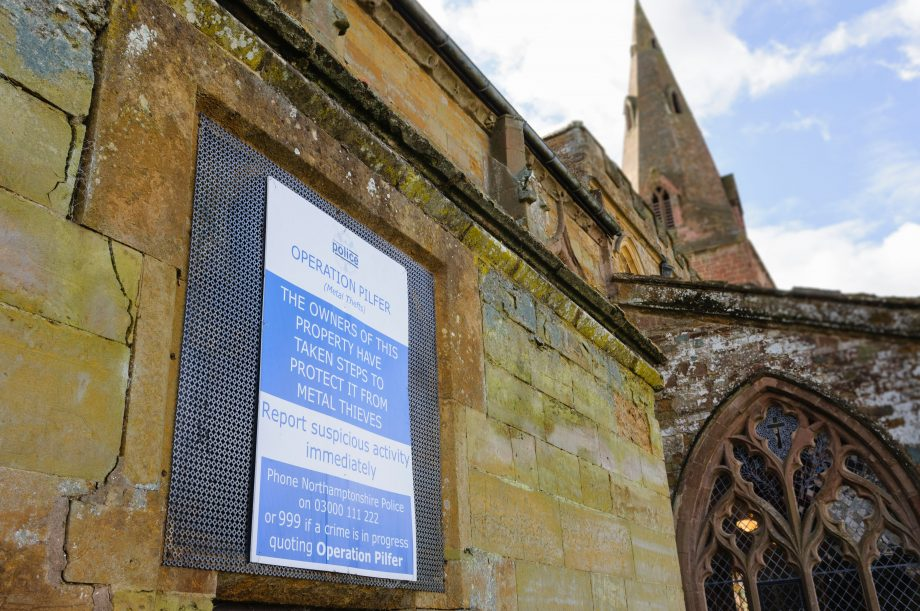 Sign on a church warning metal thieves that steps have been taken to prevent theft.