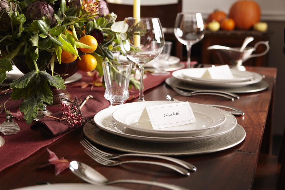 Table settings with place cards and autumn foliage