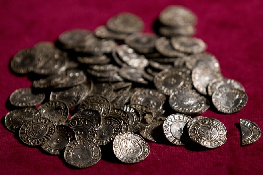 The Lenborough Hoard, unlike that found by Powell and Layton, was correctly handled throughout. These Anglo-Saxon coins, pictured while on display at the British Museum in 2015, were found by Paul Coleman. He and the owner of the land shared a reward based on a £1.35 million valuation of the hoard, which consisted of 5,200 silver pennies and two cut half pennies of kings Æthelred II (978-1016) and Cnut (1016-35). The hoard was discovered in a lead sheet on a metal-detecting rally near the village of Lenborough, Buckinghamshire in 2014.