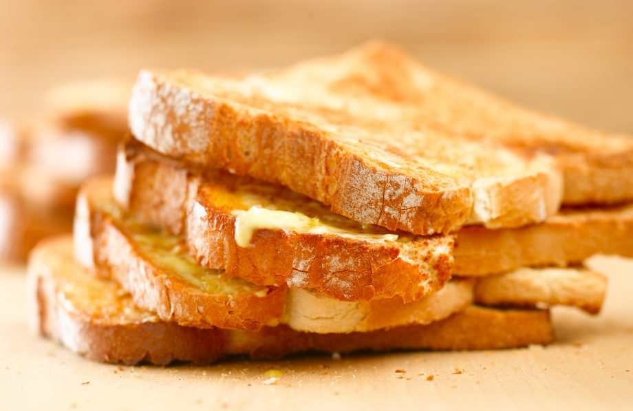 Stack of buttered toast