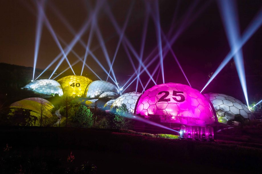A night time view of the Eden Project Biomes lit as giant National Lottery balls