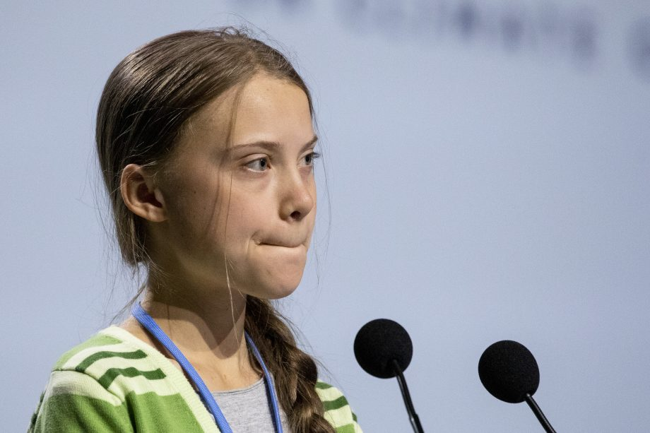 MADRID, SPAIN - DECEMBER 11: Swedish environment activist Greta Thunberg gestures as she gives a speech at the plenary session during the COP25 Climate Conference on December 11, 2019 in Madrid, Spain.