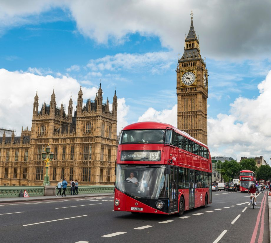 Red double-decker bus on the Westminster Bridge, Westminster Palace and Big Ben, London, England, Great Britain