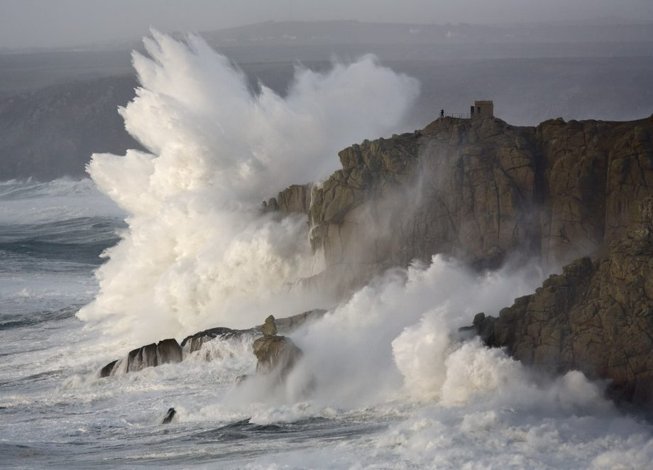 Massive waves breaking on headland, Cornwall, England