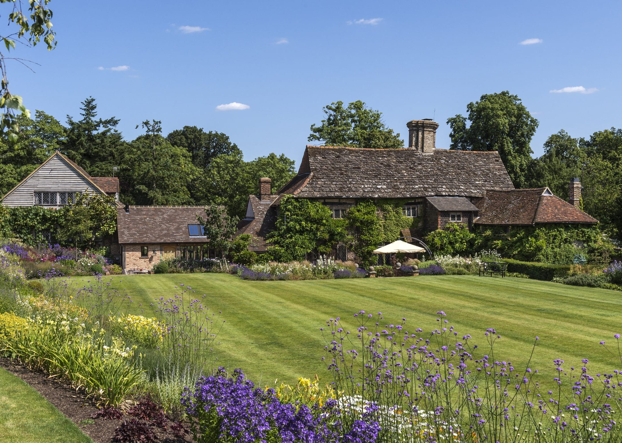 A picture-perfect Elizabethan country house once owned by the impresario who created Bucks Fizz