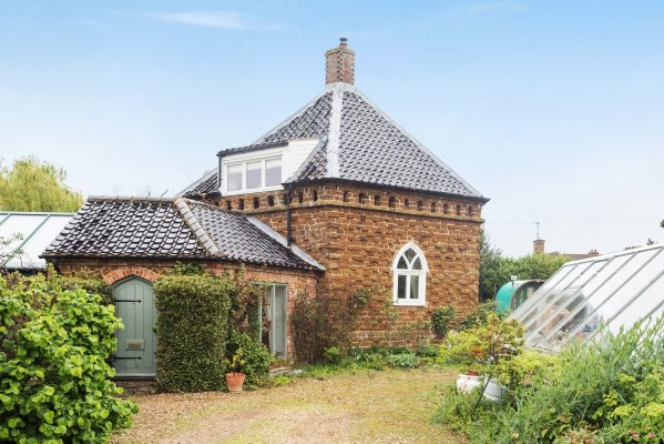A curiously-shaped country cottage in East Anglia, with a beautiful orchard and a scandalous history - Country Life