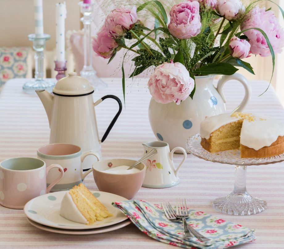 J7AGDY Sponge cake, enamel teapot and pink peonies on striped table cloth from Susie Watson Designs