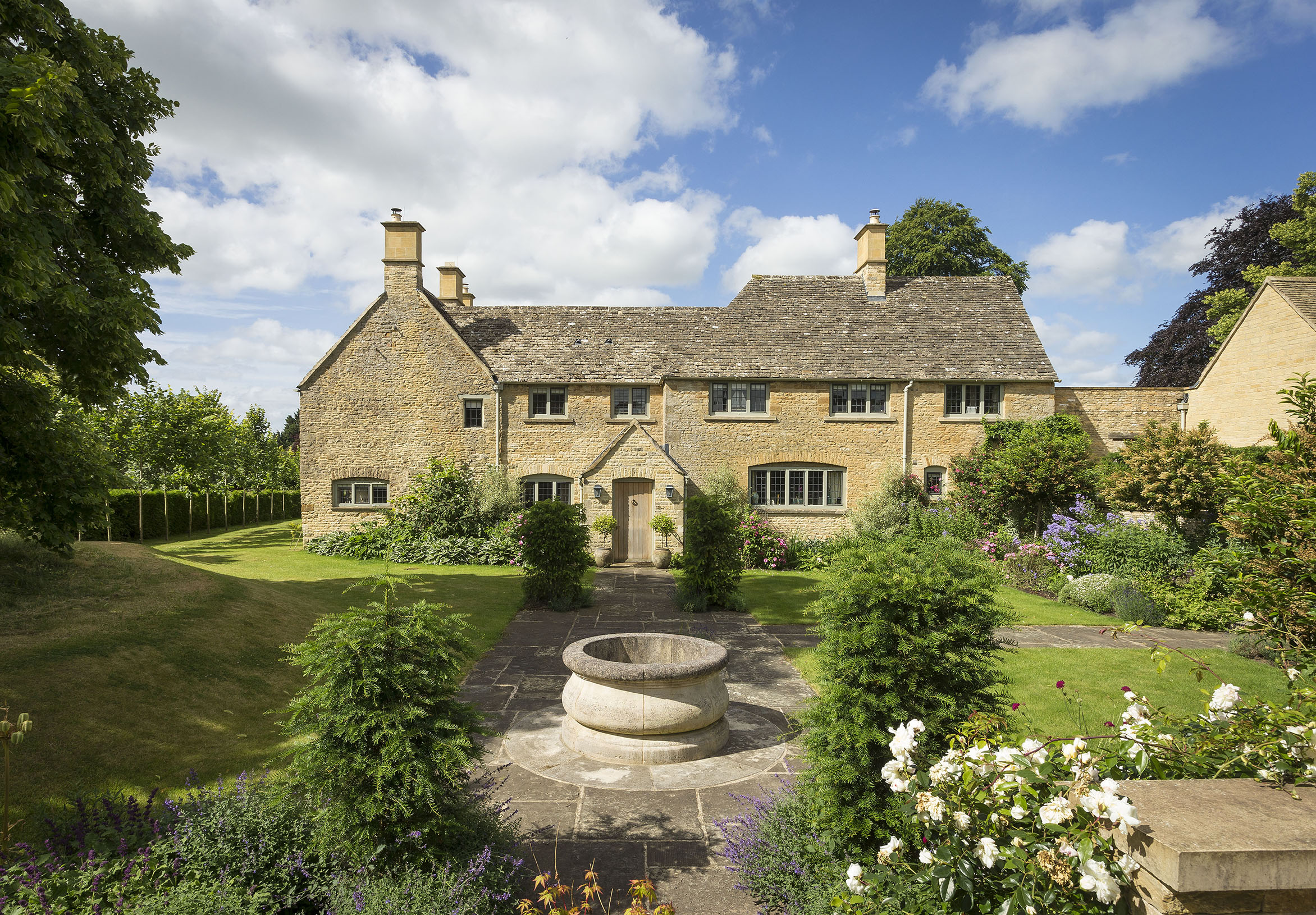 A charming Cotswold home where the Aga and leaded windows sit alongside some very 21st century interiors - Country Life
