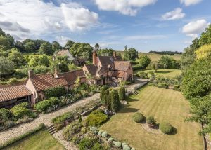 A legendary British novelist's Suffolk retreat comes up for sale, including the thatched studio where he wrote 1