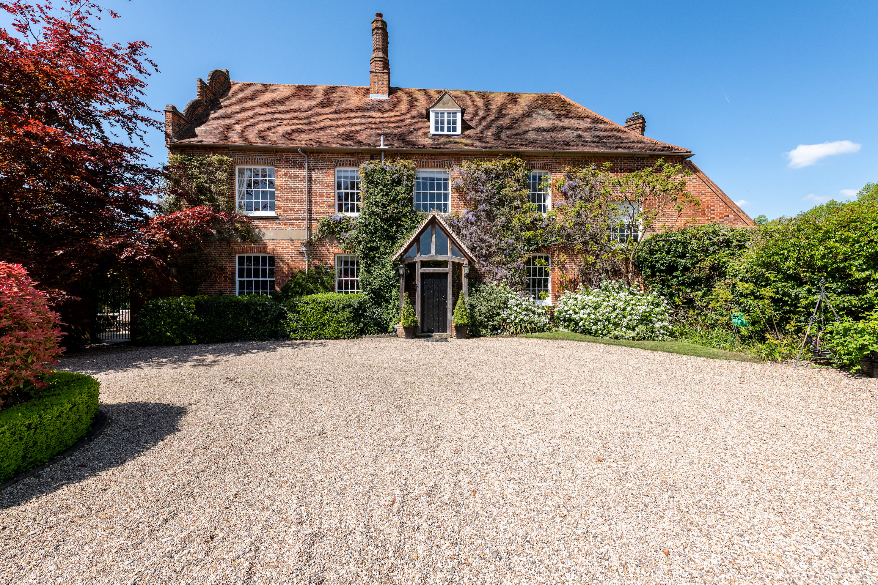 A Grade II-listed red-brick house with swimming pool in a lovely Essex village - Country Life