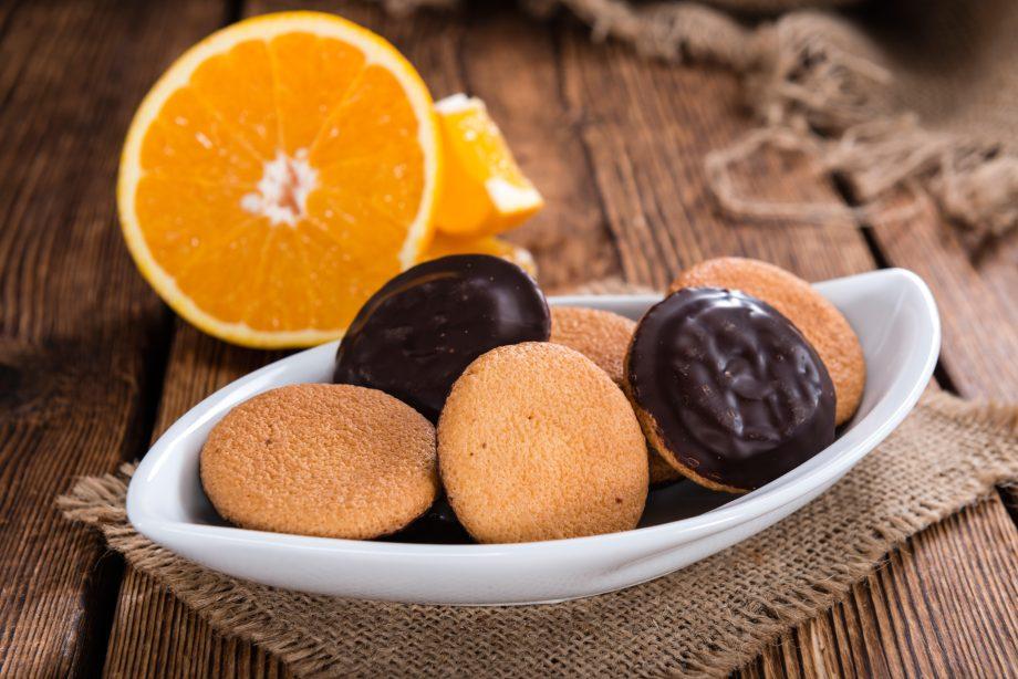 Jaffa Cakes (Orange) as close-up shot on wooden background