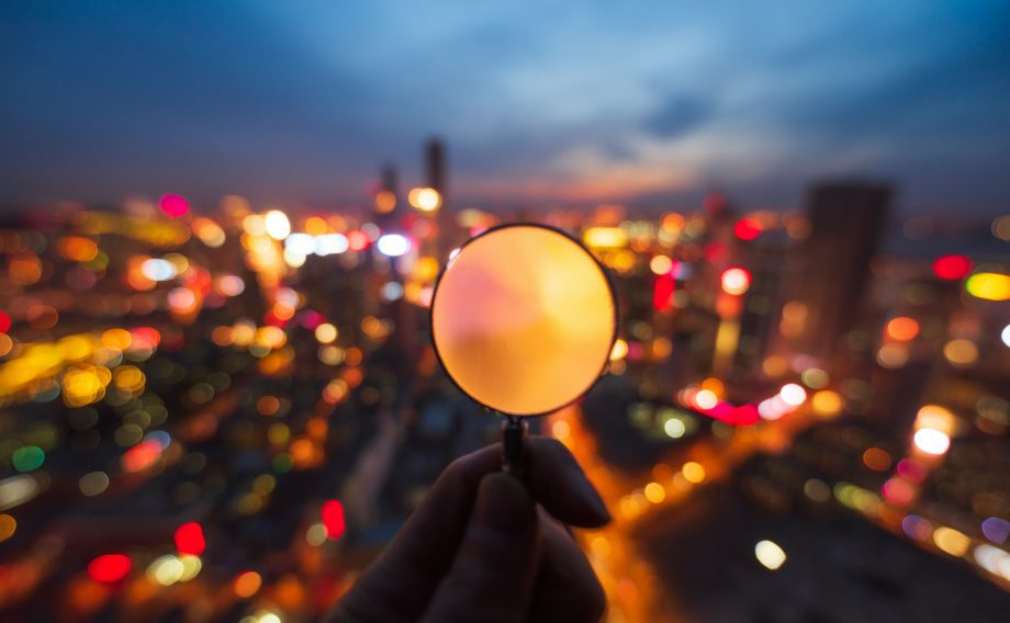Observing the bustling city through magnifier