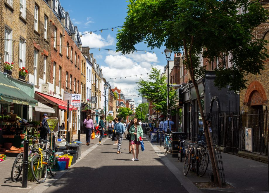 Pedestrians browse shops and restaurants on Exmouth Market in London.
