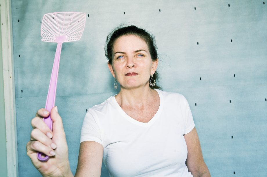 Woman Holding a Fly Swatter