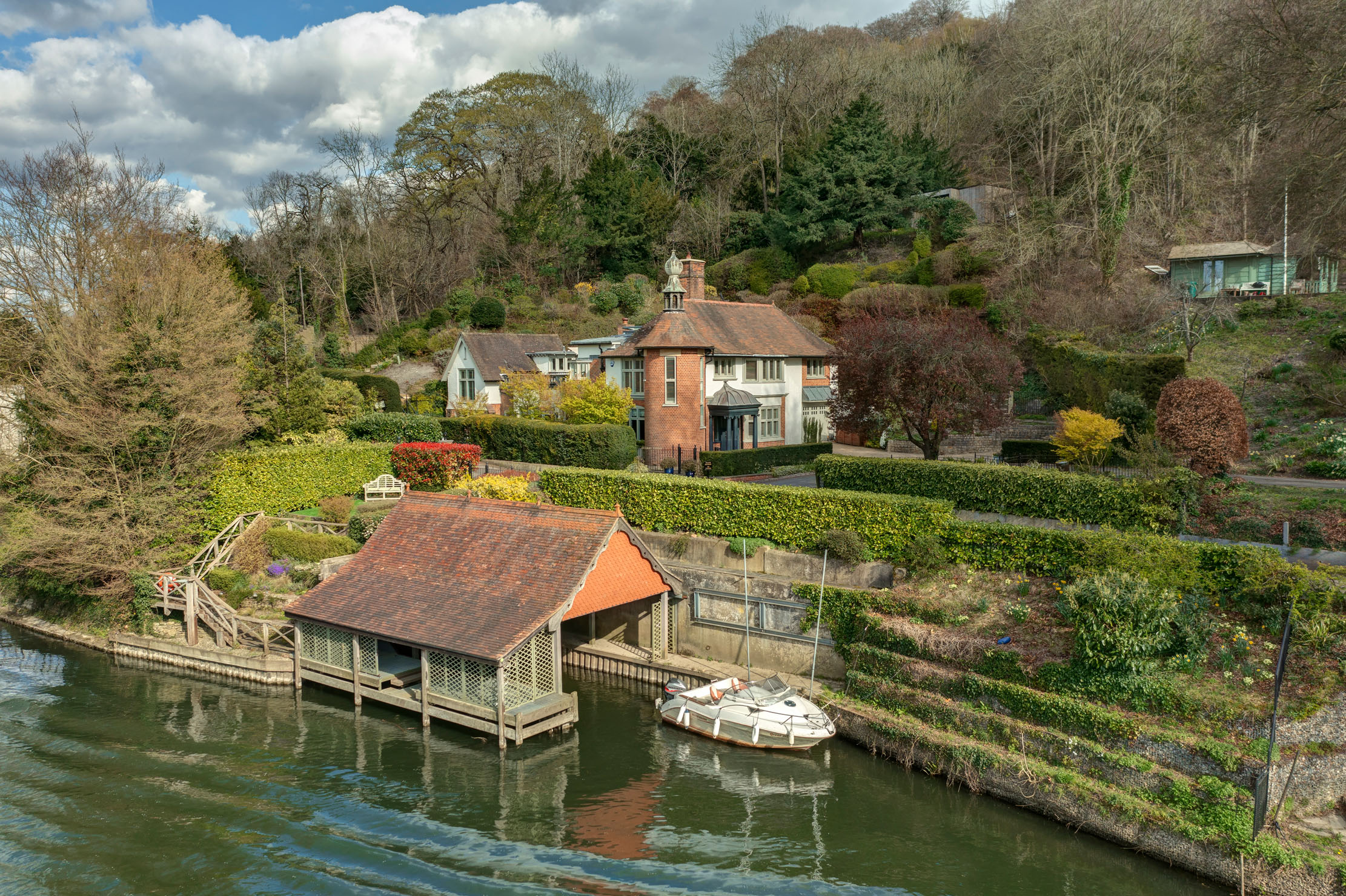 A wonderfully unique house set on the River Thames that comes with its own boathouse, a 120 ft mooring and separate studio - Country Life