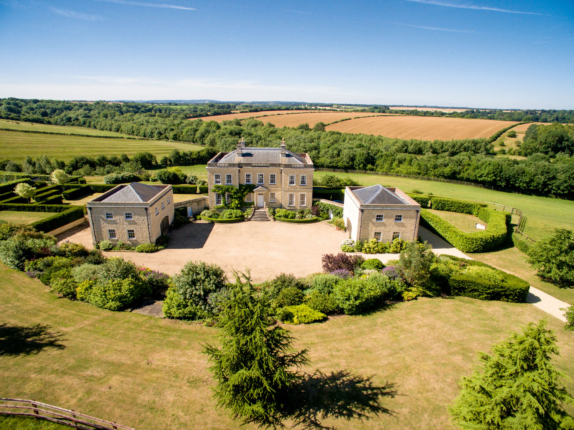 A neo-Classical 338-acre equestrian estate on the edge of the Cotswolds, complete with pavilions, indoor pool and wine cellar - Country Life