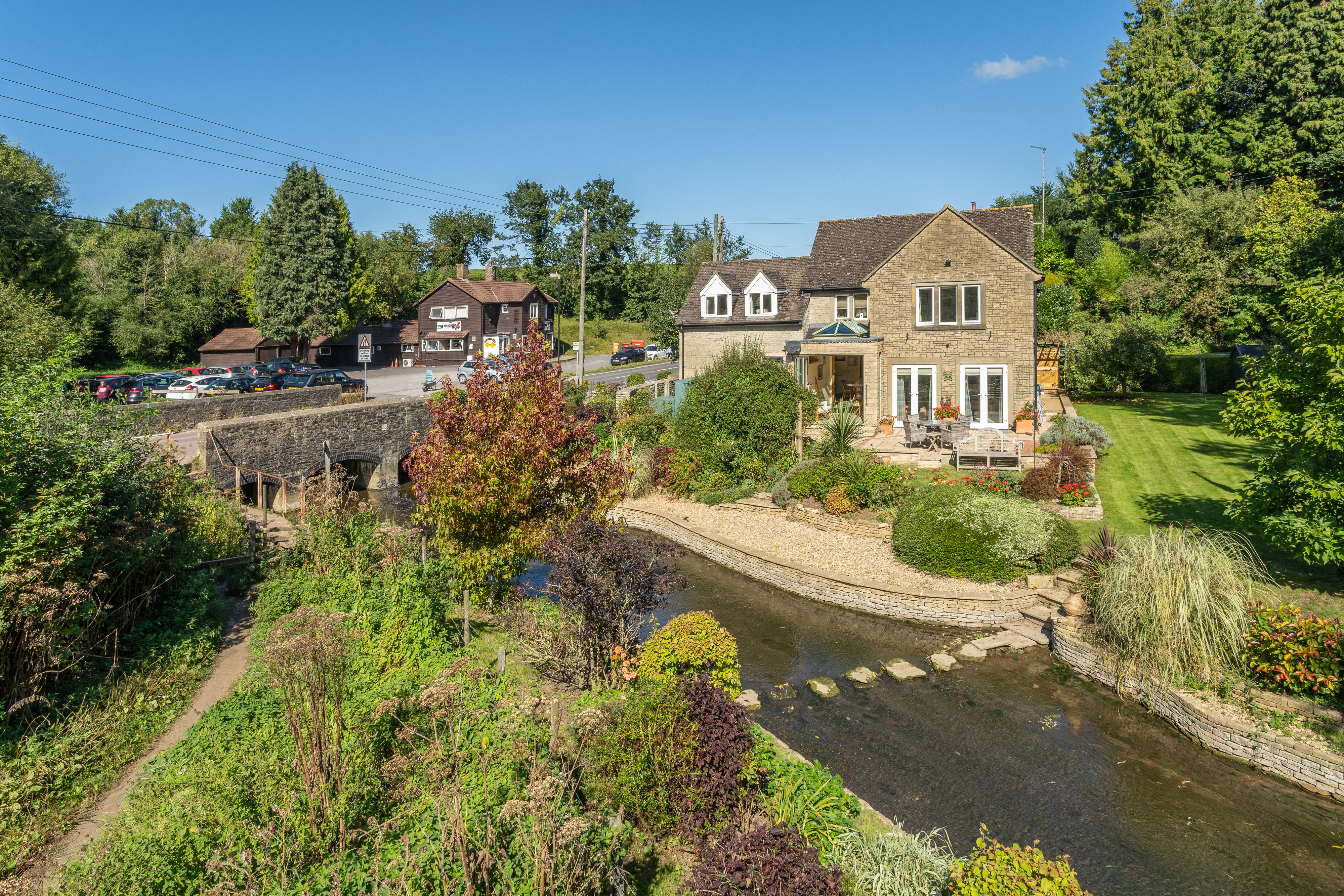 A riverside home located on the edge of the Cotswold Area of Outstanding Natural Beauty where the River Avon flows through the garden - Country Life